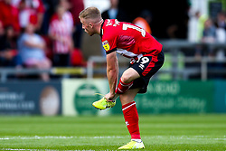 Joe Morrell of Lincoln City puts his boot back on after losing it - Mandatory by-line: Robbie Stephenson/JMP - 14/09/2019 - FOOTBALL - Sincil Bank Stadium - Lincoln, England - Lincoln City v Bristol Rovers - Sky Bet League One