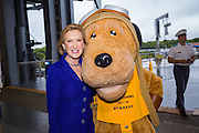 Former CEO and GOP presidential hopeful Carly Fiorina poses with mascot Scrappy as she arrives at the USS Yorktown aircraft carrier museum to attend the South Carolina Young College Republicans mixer October 2, 2015 in Mt Pleasant, South Carolina. Florina attended despite extreme weather as Hurricane Joaquin passes offshore.