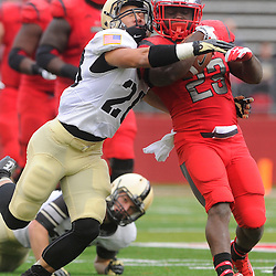 10 November 2012: Army Black Knights defensive back Justin Allen (28) wraps and tackles Rutgers Scarlet Knights running back Jawan Jamison (23) during NCAA college football action between the Rutgers Scarlet Knights and Army Black Knights at High Point Solutions Stadium in Piscataway, N.J..