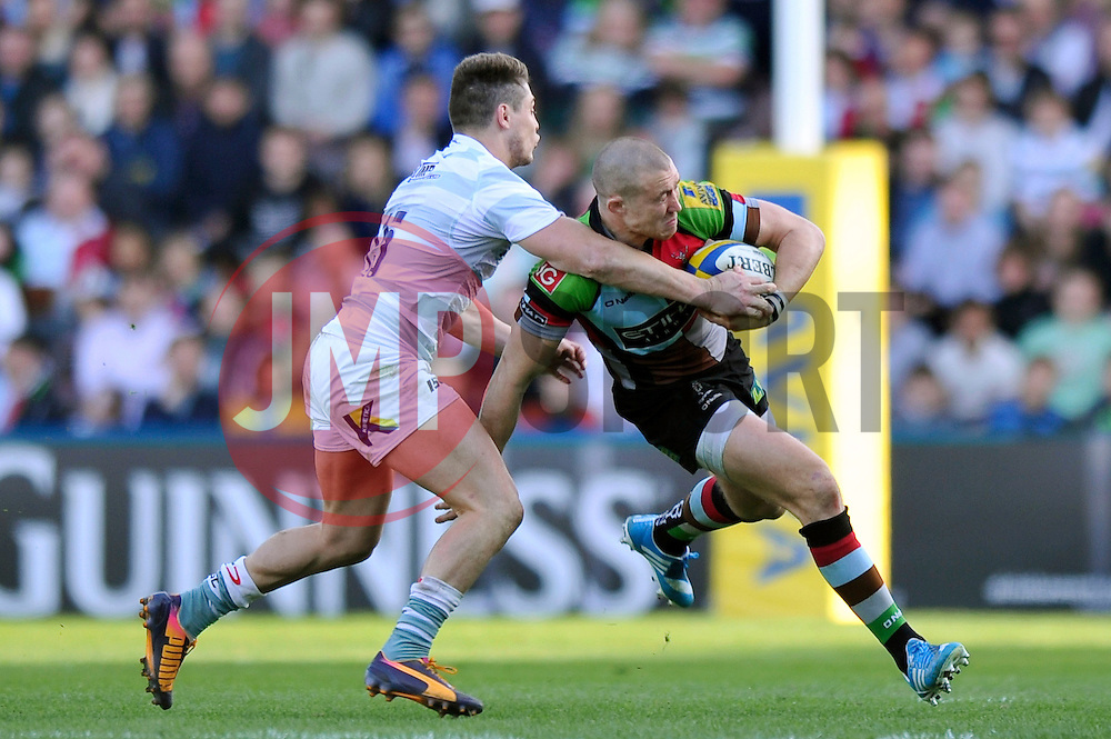 Mike Brown (Harlequins) is tackled by James O'Connor (London Irish) - Photo mandatory by-line: Patrick Khachfe/JMP - Tel: Mobile: 07966 386802 29/03/2014 - SPORT - RUGBY UNION - The Twickenham Stoop, London - Harlequins v London Irish - Aviva Premiership.