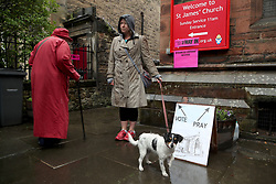 Voters outside a polling station in St James' Church, Edinburgh as voters head to the polls across the UK to vote in the General Election.