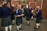 A pipe band dressed in football shirts assembling inside the stadium before playing the national anthems at the European Championship qualifying match between Scotland and the Republic of Ireland at Celtic Park, Glasgow. Scotland won the match by one goal to nil, scored by Shaun Maloney 16 minutes from time. The match was watched by 55,000 at Celtic Park, the venue chosen to host the match due to Hampden Park's unavailability following the 2014 Commonwealth Games.
