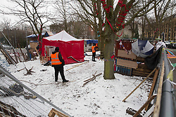 © Licensed to London News Pictures.09/02/2021, London,UK. Bailiffs act under instructions from Islington Council to evict the Highbury Corner Tree Protection Camp in north London. The camp is not strictly part of campaign to stop HS2. Bailiffs entered the camp at 5am and discovered the tunnel underneath the square. It is planned to cut trees for the new six-story building. Photo credit: Marcin Nowak/LNP