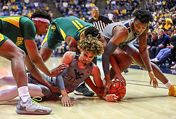 Mar 7, 2020; Morgantown, West Virginia, USA; Baylor Bears forward Flo Thamba (0) and West Virginia Mountaineers forward Emmitt Matthews Jr. (11) and Baylor Bears guard Mark Vital (11) and West Virginia Mountaineers forward Gabe Osabuohien (3) dive for a loose ball during the second half at WVU Coliseum. Mandatory Credit: Ben Queen-USA TODAY Sports