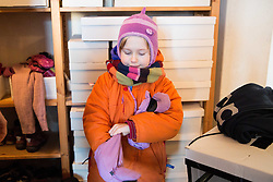 5 years old girl in winter clothes in apartment preparing to go out to kindergarden, on January 22, 2016 in Berlin, Germany. Photo by Vid Ponikvar / Sportida