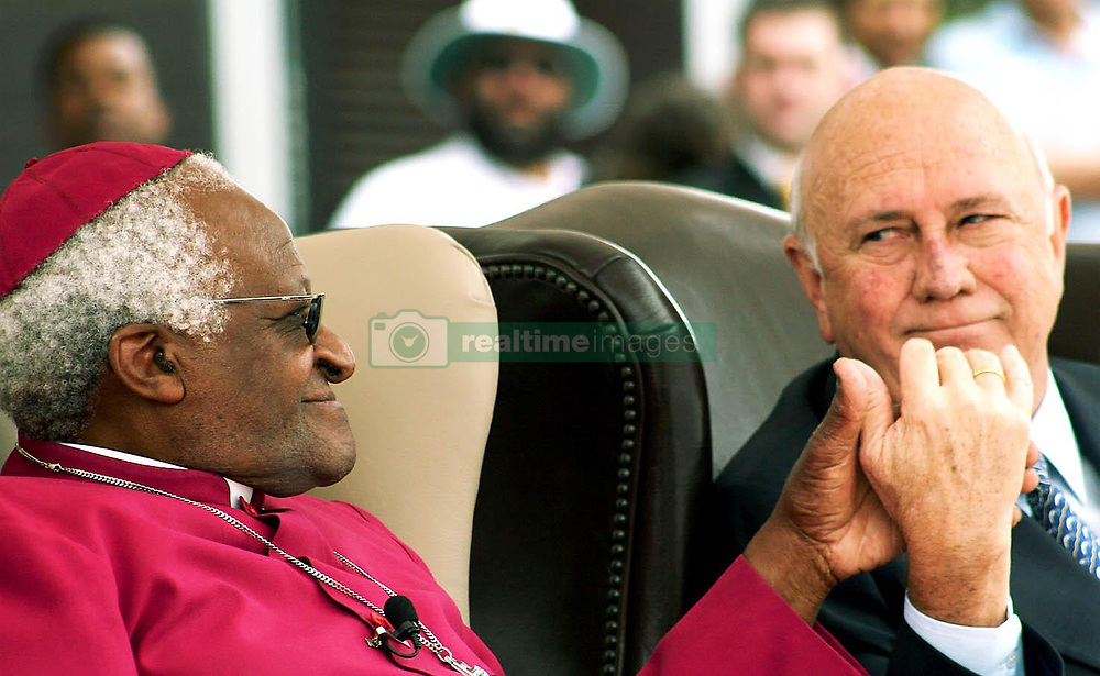 Reconciliation Day.<br />Friday 16th Decemeber 2005.<br />Nobel Square, V & A Waterfront,<br />Cape Town, South Africa.<br /><br />NOBEL SQUARE UNVEILING!<br /><br />Two Nobel Peace Prize Laureates Share Their Peace!<br /><br />Archbishop Emeritus Desmond Tutu & former State President Mr. FW de Klerk join hands during the Nobel Square unveiling ceremony.<br /><br />South Africa's four Nobel Peace Prize Laureates are honoured for their extraordinary achievements of peace & democracy in South Africa with the official unveiling of a sculptural square in the historical heart of Cape Town.<br /><br />Nobel Square is the new home of sculptures of the late Nkosi Albert Luthuli, Archbishop Emeritus Desmond Tutu, former State President FW de Klerk & former President Nelson Mandela as well as a fifth sculpture called 'Peace & Democracy' which is a narrative work acknowledging the contribution of women & children to the attainment of peace in South Africa.<br /><br />PICTURE: MARK WESSELS.