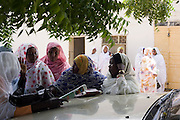 Ladies attending the first-ever international Conference on Womens' Challenge in Darfur, discuss politics in a compound belonging to the Govenor of North Darfur in Al Fasher (also spelled, Al-Fashir) where the women from remote parts of Sudan gathered to discuss peace and political issues.