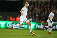 Mike van der Hoorn of Swansea city in action. Premier league match, Swansea city v Liverpool at the Liberty Stadium in Swansea, South Wales on Monday 22nd January 2018. <br /> pic by  Andrew Orchard, Andrew Orchard sports photography.