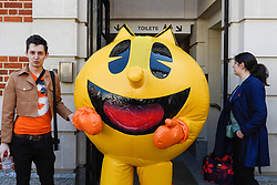 © Licensed to London News Pictures. 08/04/2017. London, UK. Pac-Man joins participants taking part in the inaugural Games Character Parade, walking from Guildhall to Paternoster Square.  The event formed part of the London Games Festival welcoming cosplayers, wearing costumes inspired by videogame characters, to the UK's biggest parade of cosplayers.   Photo credit : Stephen Chung/LNP