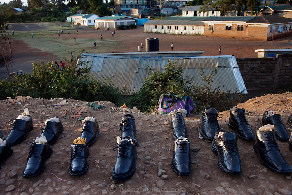 Used shoes for sale along railway tracks in the Kibera slum, Nairobi, Kenya. (From the book What I Eat: Around the World in 80 Diets.)  Kibera is Africa's biggest slum with nearly one million inhabitants.