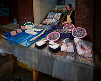 Fishmonger in the Medina of Fes. Image taken with a Fuji X-T1 camera and Zeiss 12 mm f/2.8 lens (ISO 200, 12 mm, f/2.8, 1/70 sec).