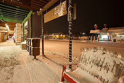 """""""Snowy Bench in Downtown Truckee"""" - Photograph of a snow covered bench made of skis in Downtown Truckee, California. Photographed in the early morning."""
