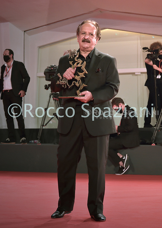 VENICE, ITALY - SEPTEMBER 12: Director Majid Majidi poses on behalf of Iranian actor Rouhollah Zamani the Special Jury Prize Marcello Mastroianni Award for Best New Young Actor during the winners photocall at the 77th Venice Film Festival on September 12, 2020 in Venice, Italy<br /> (Photo by Rocco Spaziani)