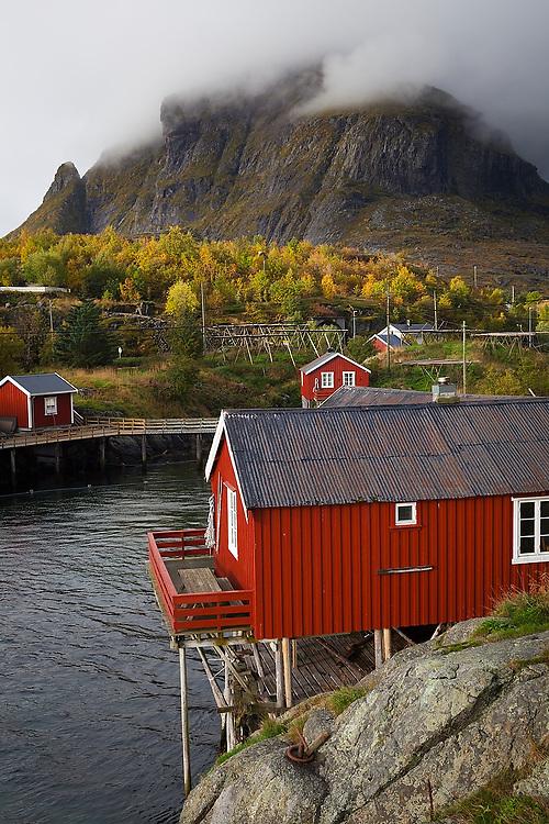 Traditional rorbu cabins overlooking the water in Å, Lofoten Islands, Norway.