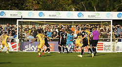 Sutton United's Will Randall (left) scores his side third goal of the game during the Sky Bet League Two match at Borough Sports Ground, Sutton. Picture date: Saturday October 9, 2021.