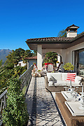 Architecture, nice terrace of a villa with comfortable divans