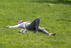 © Licensed to London News Pictures. 07/06/2021. London, UK. A woman relaxes during sunny weather in Greenwich Park in South East London. Temperatures are expected to rise with highs of 24 degrees forecasted for parts of London and South East England today . Photo credit: George Cracknell Wright/LNP