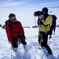 ANTARCTICA, Mike Graber films Jon Krakauer on summit of Rakekniven spire.