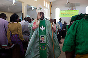 The Archbishop of Jos, Ignatius Kaigama, 54, is blessing devotees before celebrating a Mass Service at the Christian Catholic Cathedral Of Our Lady Fatima in Jos, Plateau State, Nigeria.