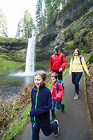 Family hiking at the South Falls, Silver Falls State Park, OR.