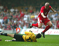 Photo: Scott Heavey<br />Wales V Azerbaijan. 29/03/03.<br />John Hartson cant get passed Jahangir Hasanzade of Azerbaijan during this afternoons Euro 2004 Group 9 qualifying match at the Millenium stadium in Cardiff.