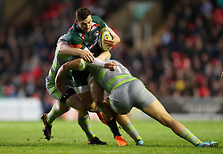Leicester Tigers Jonny May is tackled by Newcastle Falcons Chris Harris and Trevor Davison during the Aviva Premiership match at Welford Road, Leicester.