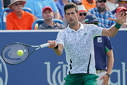 August 19, 2018 - Mason, Ohio, USA - Novak Djokovic (SRB) hits a forehand shot during Sunday's final round of the Western and Southern Open at the Lindner Family Tennis Center, Mason, Oh. (Credit Image: © Scott Stuart via ZUMA Wire)