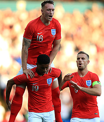 England's Marcus Rashford (left) celebrates scoring his side's first goal of the game during the International Friendly match at Elland Road, Leeds.