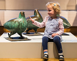Hundreds of objects from Edinburgh's museum and gallery collections have been drawn together and placed on display for the very first time.<br /> <br /> Spanning 60,000 years and over 300 items, Edinburgh Alphabet: An A-Z of the City's Collections combines artworks and artefacts across four floors of the City Art Centre this summer (Friday 19 May – 8 October).<br /> <br /> Rare and unusual museum items on display for the first time include architect Thomas Hamilton's winning design for the Burns Monument in 1831 and intricate set designs for King's Theatre pantomimes, which have been conserved ahead of their unveiling in Edinburgh Alphabet.<br /> <br /> They are being displayed alongside stone-age discoveries from archaeological excavations, unique examples of historic glass and ceramics from the Council's applied art collections, toys from the Museum of Childhood and favourites from the City Art Centre collection, including John Duncan's Tristan and Isolde, Cadell's Black Hat and a newly acquired painting Moon by Alison Watt.<br /> <br /> The display coincides with the Scottish Government's Year of History, Heritage and Archaeology and this summer's Edinburgh Art Festival.<br /> <br /> Pictured: Three year old Maddie Pearce with three of the sculpted pigeons by Shona Kinloch which previously were on display on Leith Walk before they were removed for the trams works to take place in the city.