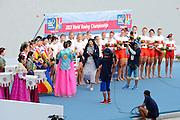 Chungju, South Korea. Women's Eights Medal presentation. FISA VP presenter, Anita DeFrantz. Gold medalist USA. W8+. Amanda POLK (b) , Kerry SIMMONDS (2) , Emily REGAN (3) , Lauren SCHMETTERLING (4) , Grace LUCZAK (5) , Meghan MUSNICKI (6) , Victoria OPITZ (7) , Caroline LIND (s) , Katelin SNYDER (c)<br /> <br /> Silver Medalist ROU. W8+. Cristina ILIE (b) , Ionelia ZAHARIA (2) , Cristina GRIGORAS (3) , Ioana CRACIUN (4) , Camelia LUPASCU (5) , Andreea BOGHIAN (6) , Roxana COGIANU (7) , Nicoleta ALBU (s) , Daniela DRUNCEA (c)<br /> <br /> Bronze Medalist CAN. W8+. Lisa ROMAN (b) , Jennifer MARTINS (2) , Carolyn GANES (3) , Susanne GRAINGER (4) , Sarah BLACK (5) , Christine ROPER (6) , Natalie MASTRACCI (7) , Cristy NURSE (s) , Kristen KIT (c). <br /> <br /> 2013 Rowing Championships, Tangeum Lake, International Regatta Course.  Sunday  01/09/2013 [Mandatory Credit. Peter Spurrier/Intersport Images]