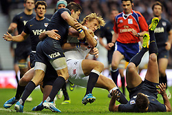 Billy Twelvetrees (England) is double-tackled - Photo mandatory by-line: Patrick Khachfe/JMP - Tel: Mobile: 07966 386802 09/11/2013 - SPORT - RUGBY UNION -  Twickenham Stadium, London - England v Argentina - QBE Autumn Internationals.