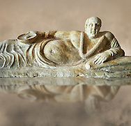 Close up of an Etruscan Hellenistic style cinerary, funreary, urn cover with a man,  National Archaeological Museum Florence, Italy .<br /> <br /> If you prefer to buy from our ALAMY PHOTO LIBRARY  Collection visit : https://www.alamy.com/portfolio/paul-williams-funkystock - Scroll down and type - Etruscan Florence - into LOWER search box. (TIP - Refine search by adding a background colour as well).<br /> <br /> Visit our ETRUSCAN PHOTO COLLECTIONS for more photos to download or buy as wall art prints https://funkystock.photoshelter.com/gallery-collection/Pictures-Images-of-Etruscan-Historic-Sites-Art-Artefacts-Antiquities/C0000GgxRXWVMLyc