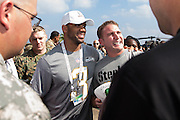 January 27 2016: Seattle Seahawks Russell Wilson takes a photo with a fan during the Pro Bowl Draft at Wheeler Army Base on Oahu, HI. (Photo by Aric Becker/Icon Sportswire)