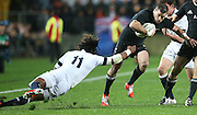 Marland Yarde of England misses Cory Jane of the All Blacks during the third rugby test between the All Blacks and England played at Waikato Stadium in Hamilton during the Steinlager Series - All Blacks v England, Hamiton, 21 June 2014<br /> www.photosport.co.nz