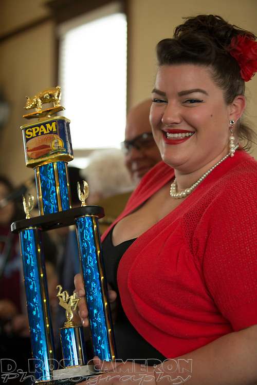 Gracie Allen of Isleton, Calif. holds the trophy she won for her Spam creation -- Spamtastic pineapple cupcakes, topped with canided Spam and pineapple cream cheese icing -- during the 19th annual Spam Festival, Sunday, Feb. 19, 2017, in Isleton. (Photo by D. Ross Cameron)