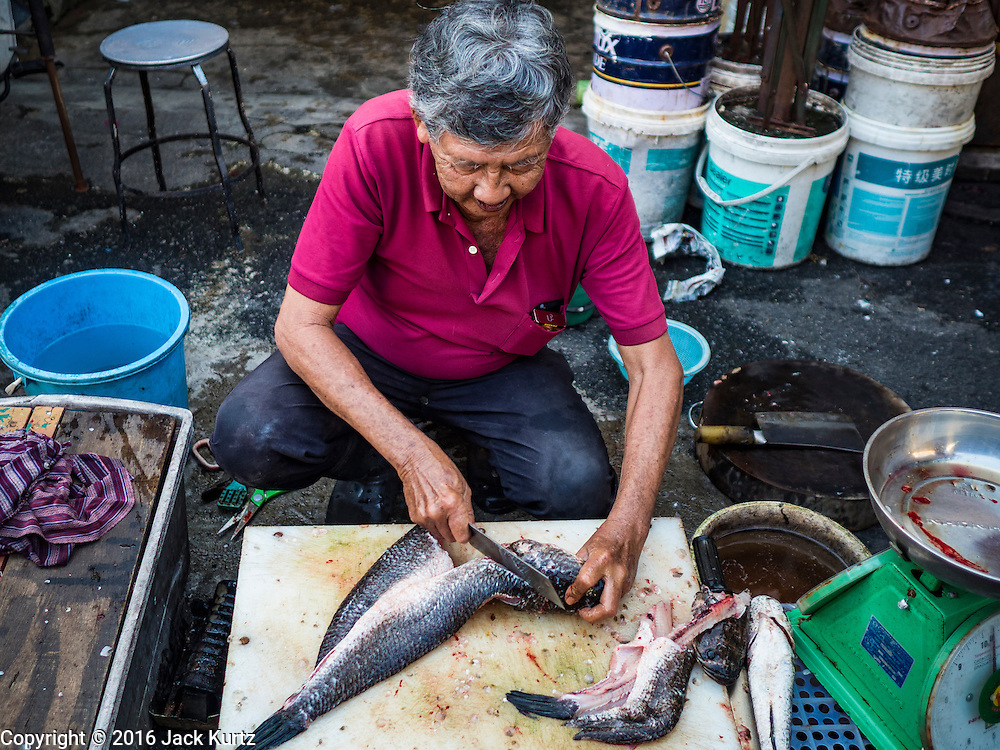 17 NOVEMBER 2016 - GEORGE TOWN, PENANG, MALAYSIA: A fish monger sells snakehead fish in a market in George Town, Penang, Malaysia. George Town is a UNESCO World Heritage city and wrestles with maintaining its traditional lifestyle and mass tourism.       PHOTO BY JACK KURTZ