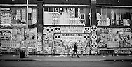 2011 October 31 - Pedestrian with postered wall, Capitol Hill, Seattle, WA, USA. Copyright Richard Walker