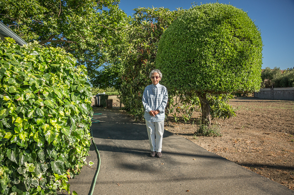 """""""I graduated from Saint Helena High School in 1943, went to work at the Mare Island Shipyard in Vallejo and continued to work there for 37 years.  I worked with some of the early computers...IBM, Honeywell, and Univac.  I bought this house in 1952 and I've been here ever since.""""  - Ninety three year old Mary Edano stands near her home in Saint Helena, California."""