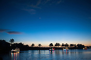 Boats travel along the Barren River into Everglades City during the Christmas Parade, December 21, 2013