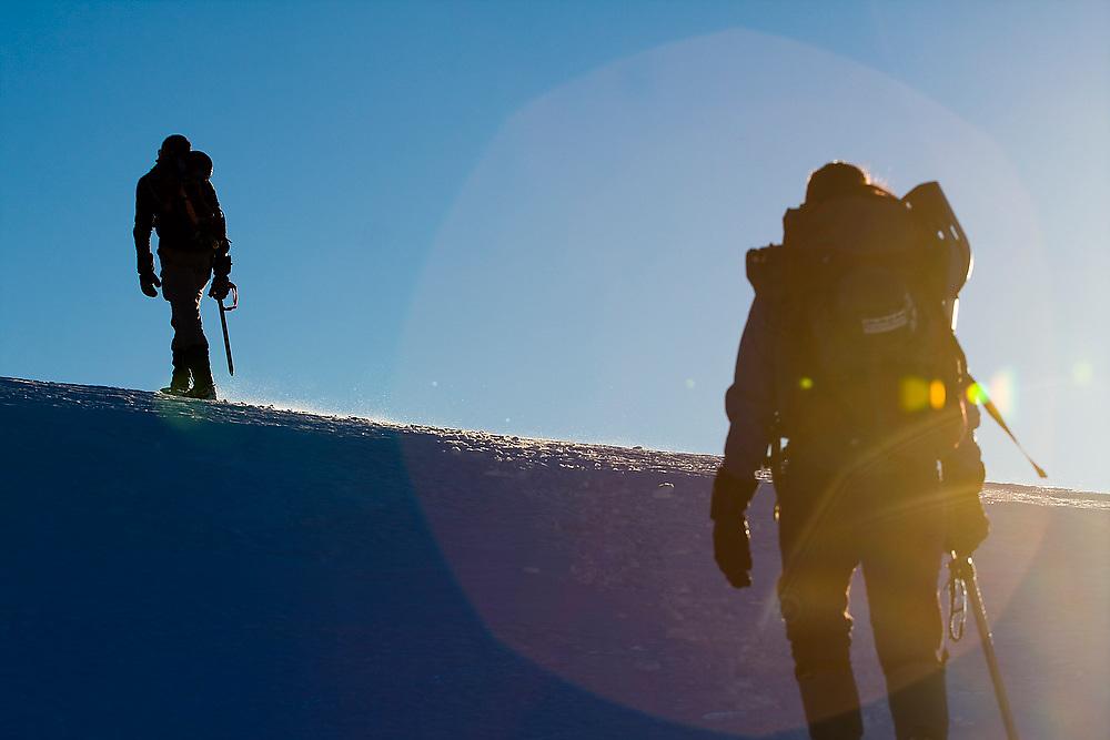 Climbers hike a high ridge on a trip to the South Picket Range, North Cascades National Park, Washington.
