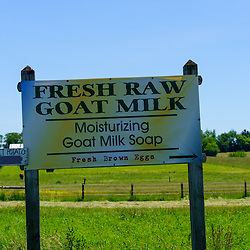 Gordonville, PA, USA / June 8, 2020: A sign offers Fresh Raw Goat Milk in a farm field in rural Lancaster County.