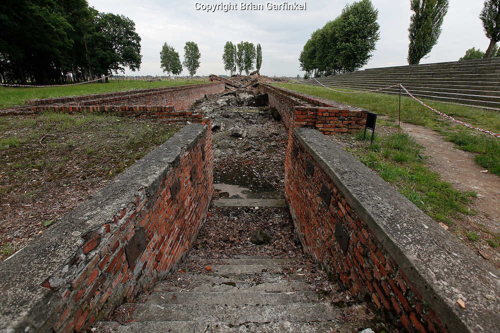 """The steps leading down to the """"dressing room"""" where victims removed their clothes before before being gassed at a destroyed crematorium in Auschwitz-Birkenau Concentration Camp in Poland on Tuesday July 5th 2011.  (Photo by Brian Garfinkel)"""