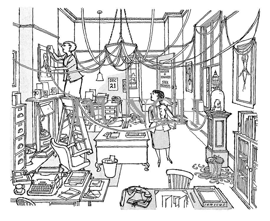 (a cartoon showing two office workers stringing up tickertape as Christmas decorations)