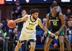 Jan 21, 2019; Morgantown, WV, USA; West Virginia Mountaineers guard Jermaine Haley (10) dribbles during the first half against the Baylor Bears at WVU Coliseum. Mandatory Credit: Ben Queen-USA TODAY Sports
