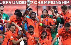 Netherlands U17's captain Daishawn Redan lifts the trophy