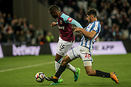 Diafra Sakho of West Ham United holds off Christopher Schindler of Huddersfield Town . Premier league match, West Ham Utd v Huddersfield Town at the London Stadium, Queen Elizabeth Olympic Park in London on Monday 11th September 2017.<br /> pic by Kieran Clarke, Andrew Orchard sports photography.