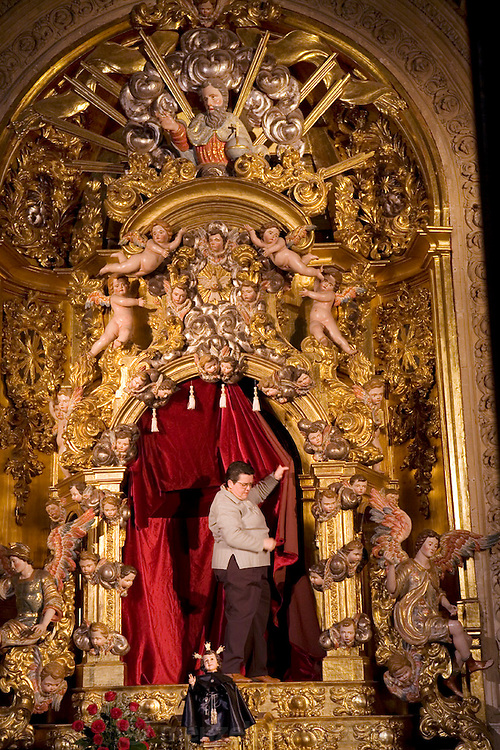 Preparing a chapel in the Cathedral for Holy Week. Salamanca, Spain during Semana Santa (Holy Week).