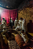 Ethiopian Orthodox men praying and chanting, Bet Amanuel, one of 11 rock hewn medieval monolithic churches in Lalibela, Ethiopia.