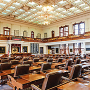 The House of Representatives chamber in the Texas State Capitol in Austin, TX. The House has 150 members and a regular session adds up to 140 days a year, and there are no term limits for representatives.