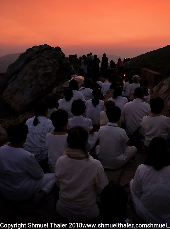 Burmese Buddhists on pilgrimage chant at sunset atop Vulture Peak in Rajgir, India. Rajgir was the first place that the Buddha and his community first owned land. <br /> Photo by Shmuel Thaler <br /> shmuel_thaler@yahoo.com www.shmuelthaler.com